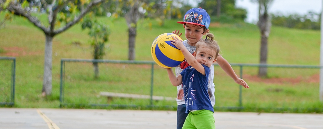Photo of the Week - Camille Sports between siblings