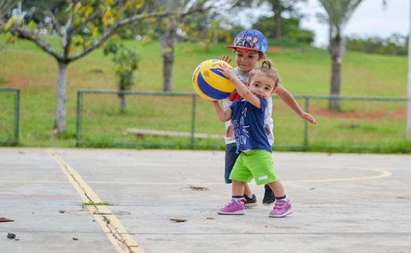 Photo of the Week - Camille Sports between siblings